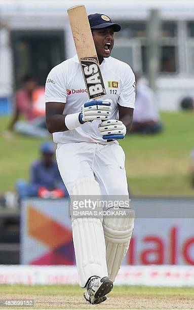 Sri Lankan cricket captain Angelo Mathews shouts as he runs between the wickets during the first day of the opening Test cricket match between Sri...