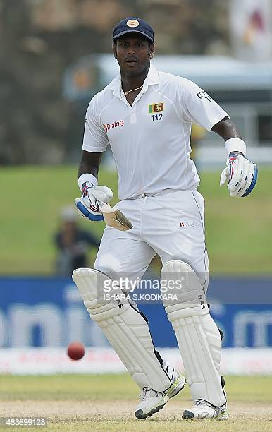 Sri Lankan cricket captain Angelo Mathews watches the ball as he runs between the wickets during the first day of the opening Test cricket match...
