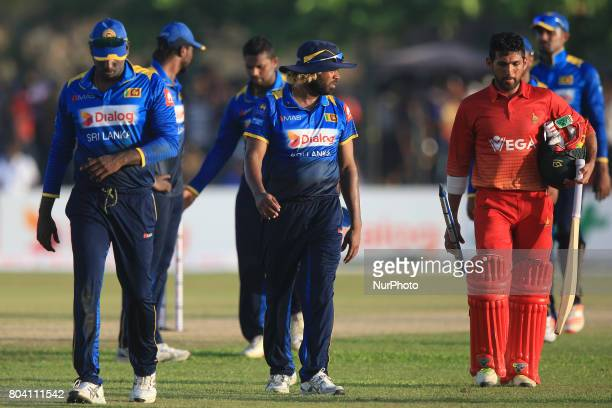 Sri Lankan cricket captain Anjelo Matthews Sri Lankan cricketer Lasith Malinga and Zimbabwe's Sikandar Raza walks back to pavilion after Zimbabwe...