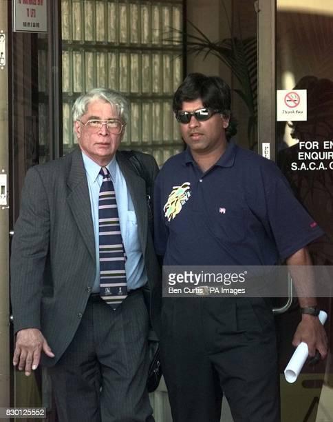 Sri Lankan Cricket Captain Arjuna Ranatunga leaves the disciplinary hearing at the Adelaide Oval accompanied by an unidentified Sri Lankan official...