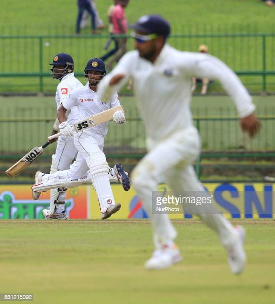 Sri Lankan cricket captain Dinesh Chandimal and Angelo Mathews run between the wickets during the 3rd Day's play in the 3rd and final Test match...