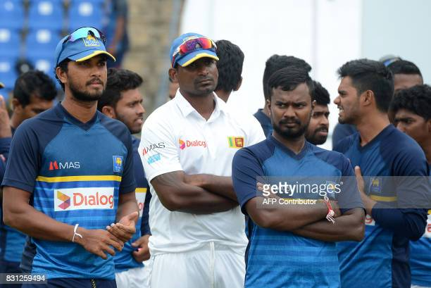 Sri Lankan cricket captain Dinesh Chandimal and his teammates react during the presentation ceremony after India's victory on the last day of the...