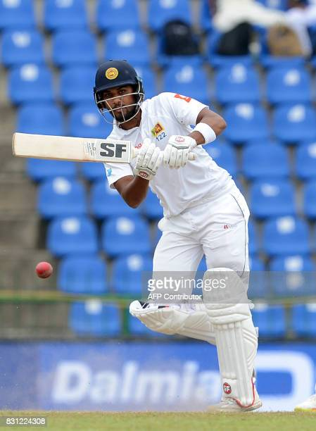 Sri Lankan cricket captain Dinesh Chandimal plays a shot during the third day of the third and final Test match between Sri Lanka and India at the...