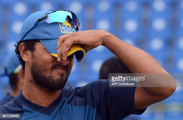 Sri Lankan cricket captain Dinesh Chandimal reacts after a presentation ceremony on the last day of the third and final Test match between Sri Lanka...