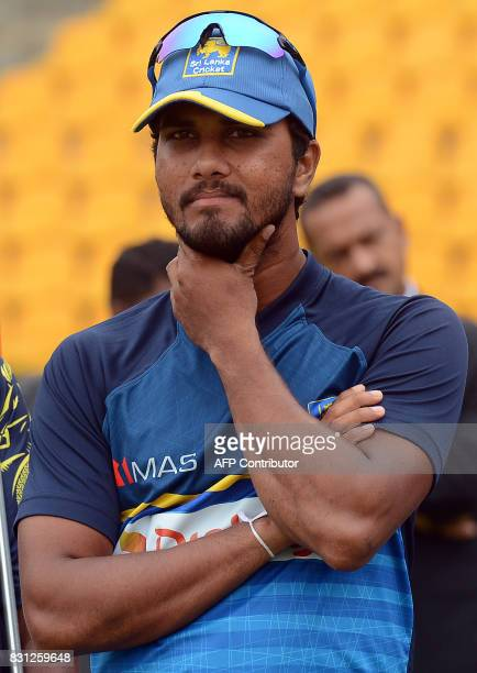 Sri Lankan cricket captain Dinesh Chandimal reacts after the presentation ceremony after India's victory on the last day of the third and final Test...