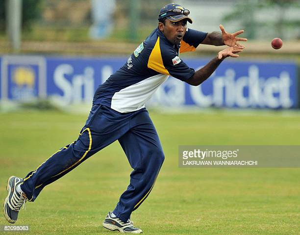 Sri Lankan cricket captain Mahela Jayawardene catches a ball during a practice session at The Galle International Cricket Stadium in Galle on July 29...