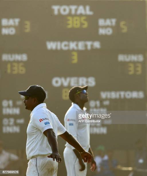 Sri Lankan cricket captain Rangana Herath and Angelo Mathews react during the first day of first Test match between Sri Lanka and India at Galle...