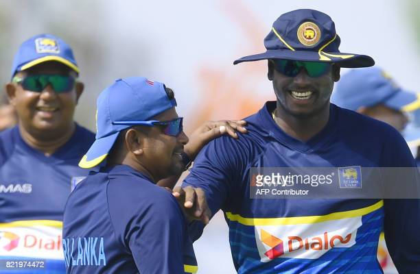 Sri Lankan cricket captain Rangana Herath and Angelo Mathews take part in a practice session at Galle International Cricket Stadium in Galle on July...