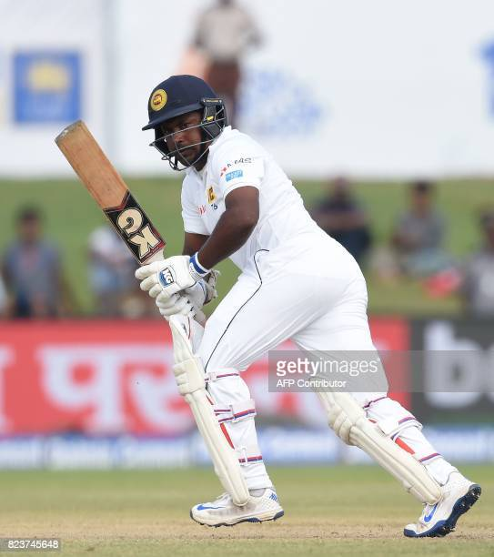 Sri Lankan cricket captain Rangana Herath plays a shot during the third day of the first Test match between Sri Lanka and India at Galle...