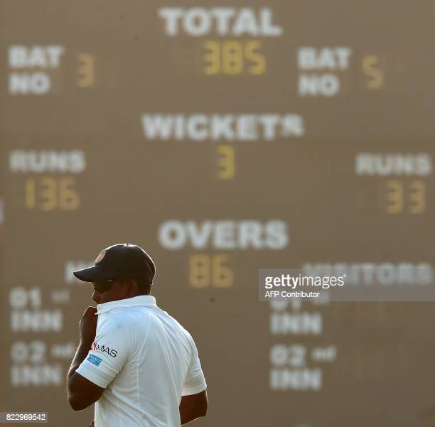 Sri Lankan cricket captain Rangana Herath reacts during the first day of first Test match between Sri Lanka and India at Galle International Cricket...