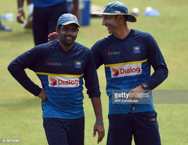 Sri Lankan cricket coach Nic Pothas chats with Dilruwan Perera during a practice session at the R Premadasa Cricket Stadium in Colombo on July 13...