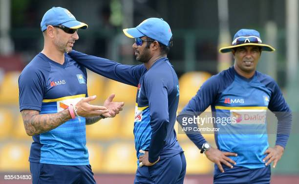 Sri Lankan cricket coach Nic Pothas speaks with captain Upul Tharanga during a practice session at the Rangiri Dambulla International Cricket Stadium...
