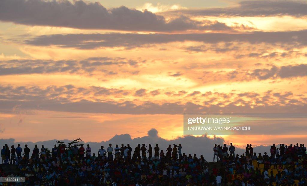 Sri Lankan cricket fans watch the second One Day International (ODI) match between Sri Lanka and Pakistan at the Suriyawewa Mahinda Rajapakse International Cricket Stadium in the southern district of Hambantota on August 26, 2014.