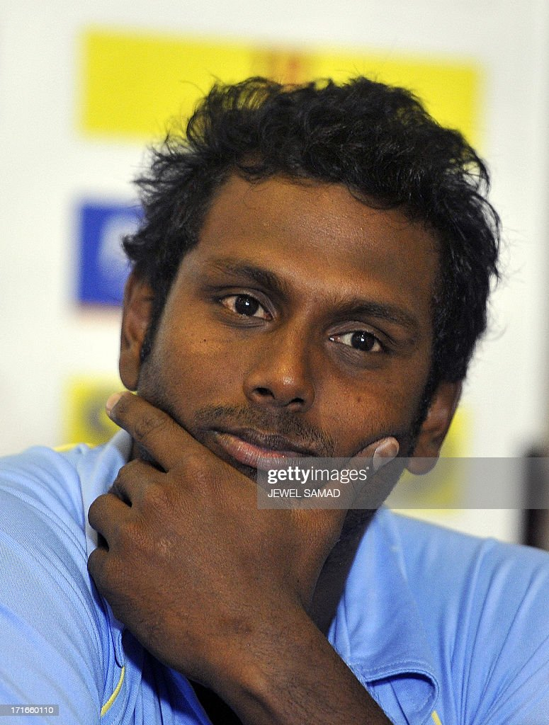 Sri Lankan cricket team captain Angelo Mathews listens to a question during an unveiling ceremony of Celkon Tri-Nation series cup in Kingston on June 27, 2013. Sri Lanka will face West Indies in the first match of a Tri Nation series involving India too. AFP PHOTO/Jewel Samad