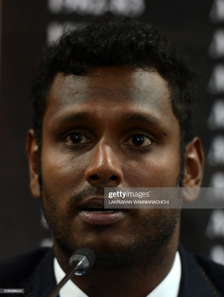 Sri Lankan cricket team captain Angelo Mathews speaks at a press conference as the team prepare to leave for their forthcoming England tour in Colombo on May 4, 2016. / AFP / LAKRUWAN