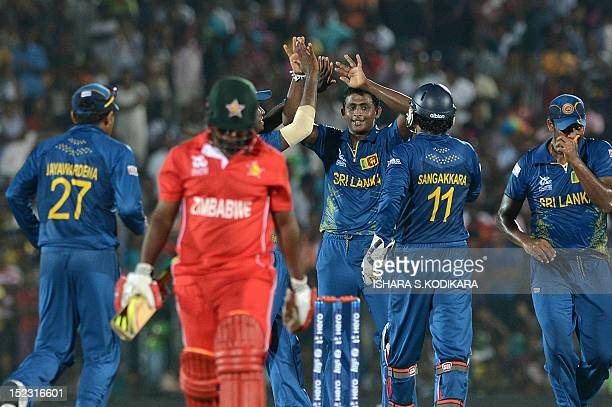 Sri Lankan cricketer Ajantha Mendis celebrates after he dismissed Zimbabwe cricketer Prosper Utseya during the ICC Twenty20 Cricket World Cup match...