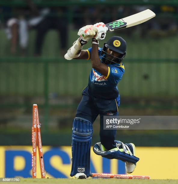 Sri Lankan cricketer Akila Dananjaya is bowled out by Indian cricketer Jasprit Bumrah during the third one day international cricket match between...
