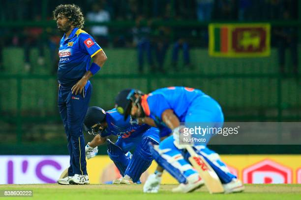 Sri Lankan cricketer and fast bowler Lasith Malinga looks on during the 2nd One Day International cricket match between Sri Lanka and India at the...