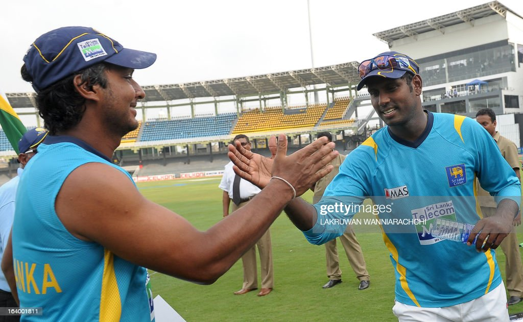 Sri Lankan cricketer and Man of the Match Kumar Sangakkara (L) is congratulated by his captain Angelo Mathews (R) after their team's victory in the second Test match between Sri Lanka and Bangladesh at the R. Premadasa Cricket Stadium in Colombo on March 19, 2013. Sri Lanka beat Bangladesh by seven wickets on the penultimate day of the second and final Test in Colombo on Tuesday to clinch the series 1-0.