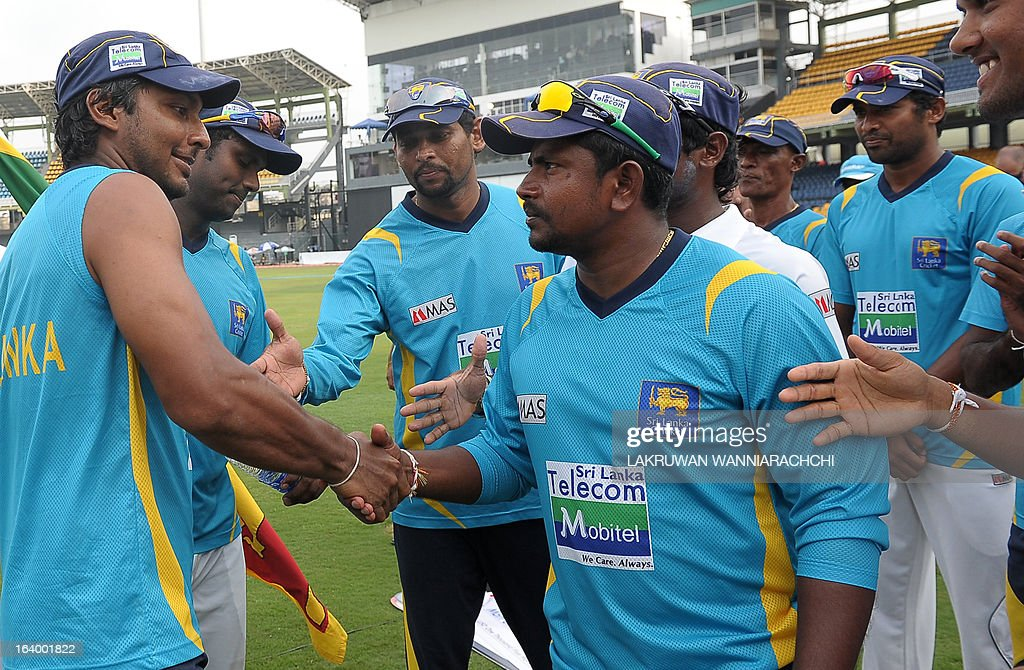 Sri Lankan cricketer and Man of the Match Kumar Sangakkara (L) is congratulated by his teammates after their team's victory in the second Test match between Sri Lanka and Bangladesh at the R. Premadasa Cricket Stadium in Colombo on March 19, 2013. Sri Lanka beat Bangladesh by seven wickets on the penultimate day of the second and final Test in Colombo on Tuesday to clinch the series 1-0.