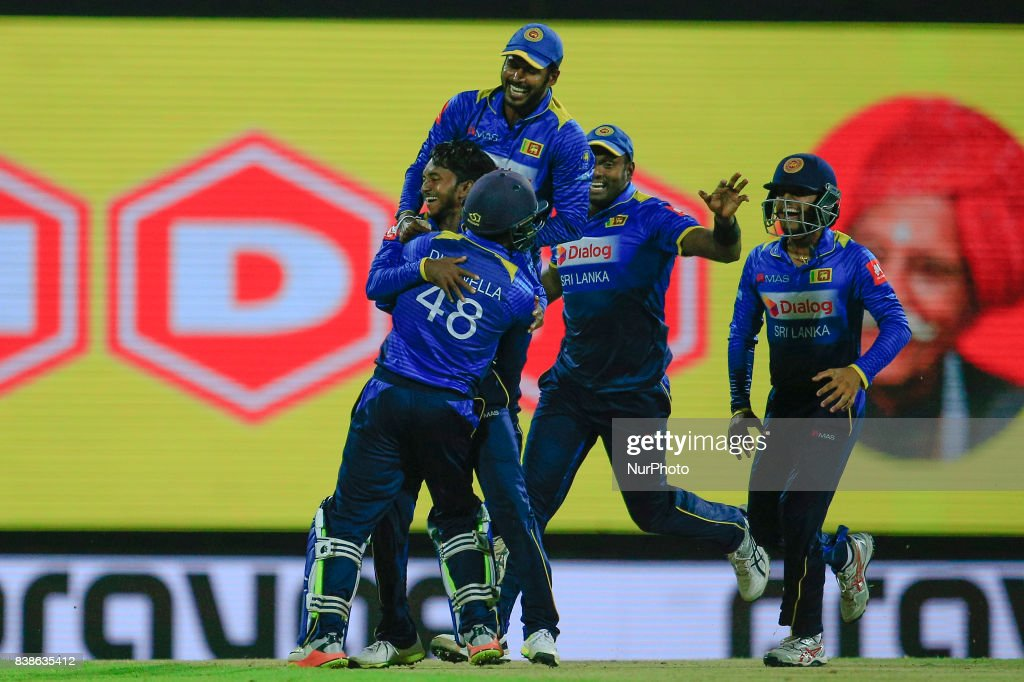 Sri Lankan cricketer and spinner Akila Dananjaya in celebration mood as he is joined by his team mates during the 2nd One Day International cricket match between Sri Lanka and India at the Pallekele international cricket stadium at Kandy, Sri Lanka on Thursday 24 August 2017.