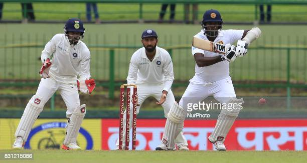 Sri Lankan cricketer Angelo Mathews plays a shot during the 3rd Day's play in the 3rd and final Test match between Sri Lanka and India at the...