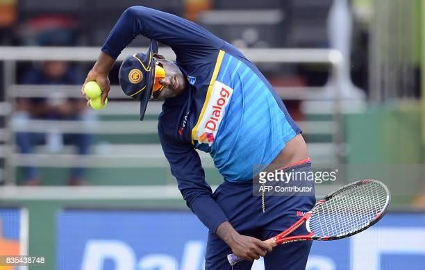 Sri Lankan cricketer Angelo Mathews stretches during a practice session at the Rangiri Dambulla International Cricket Stadium in Dambulla on August...