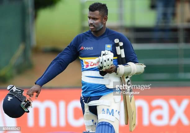 Sri Lankan cricketer Angelo Mathews walks to bat during a practice session at the Rangiri Dambulla International Cricket Stadium in Dambulla on...
