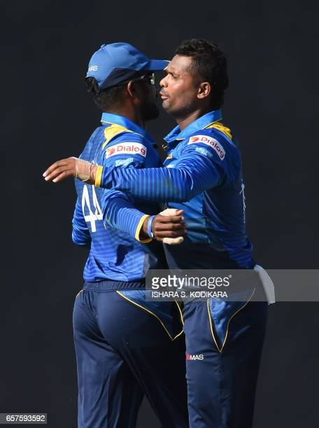 Sri Lankan cricketer Asela Gunaratne celebrates with Sri Lanka's captain Upul Tharanga after he dismissed Bangladesh batsman Sabbir Rahman during the...