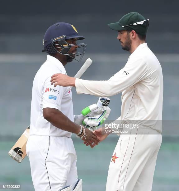 Sri Lankan cricketer Asela Gunaratne shakes hands with Zimbabwe cricket captain Graeme Cremer after Sri Lanka beat Zimbabwe by four wickets on the...