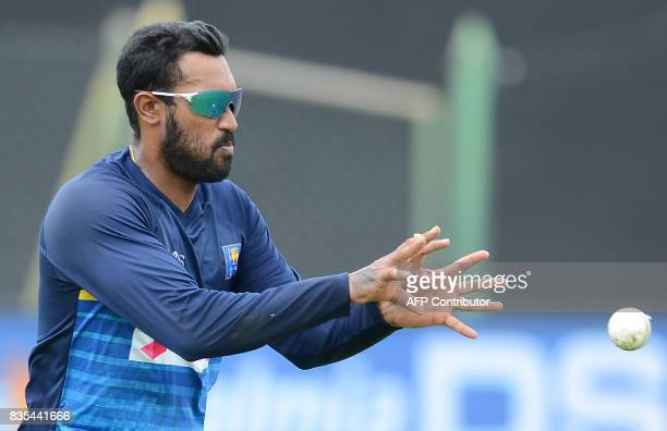 Sri Lankan cricketer Chamara Kapugedera catches a ball during a practice session at the Rangiri Dambulla International Cricket Stadium in Dambulla on...