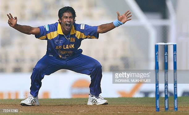 Sri Lankan cricketer Chaminda Vaas appeals against unseen New Zealand cricketer Lou Vincent during their ICC Champions Trophy 2006 match in Mumbai 20...