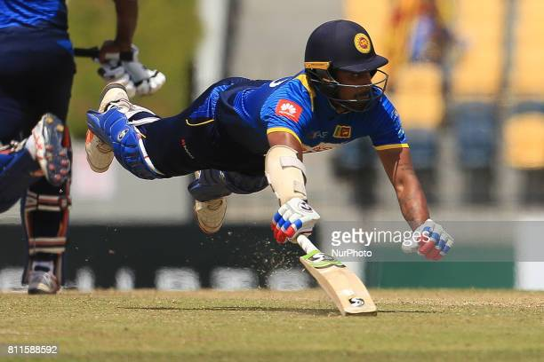 Sri Lankan cricketer Danushka Gunathilaka dives in for a run during the 5th One Day International cricket matcth between Sri Lanka and Zimbabwe at...