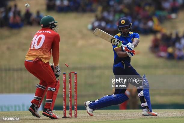 Sri Lankan cricketer Danushka Gunathilaka gets bowled out during the 4th One Day International cricket matcth between Sri Lanka and Zimbabwe at...