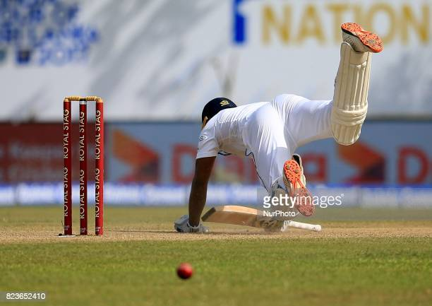 Sri Lankan cricketer Danushka Gunathilaka loses his balance and falls down on his knees after facing a ball by Indian pacer Mohammed Shami during the...
