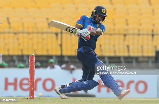 Sri Lankan cricketer Danushka Gunathilaka plays a shot during the third oneday international cricket match between Sri Lanka and Zimbabwe at the...
