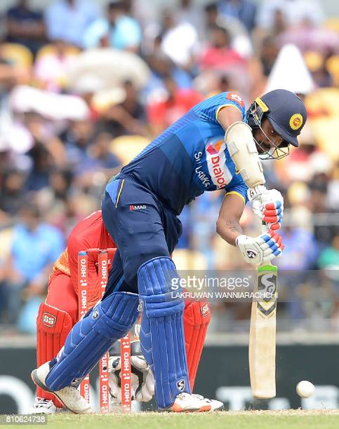 Sri Lankan cricketer Danushka Gunathilaka plays a shot during the fourth oneday international cricket match between Sri Lanka and Zimbabwe at the...