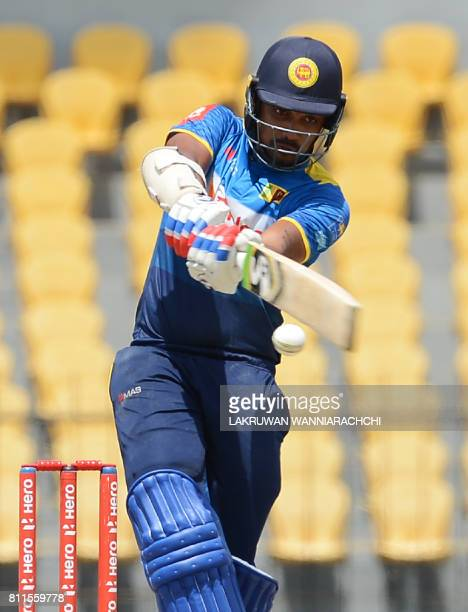 Sri Lankan cricketer Danushka Gunathilaka plays a shot during the fifth oneday international cricket match between Sri Lanka and Zimbabwe at the...
