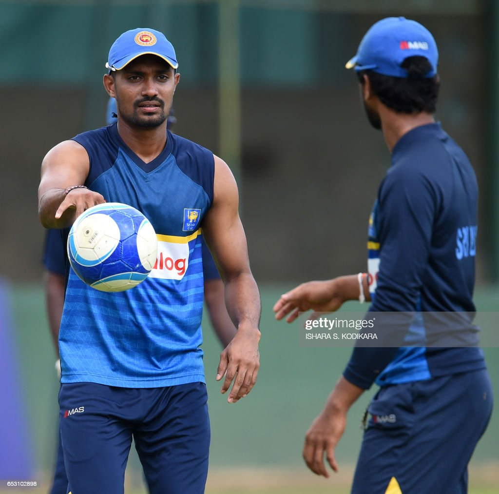 Sri Lankan cricketer Danushka Gunathilaka (L) plays football during a practice session at The P. Sara Oval Cricket Stadium in Colombo on March 14, 2017. Bangladesh play their 100th Test on March 15, against Sri Lanka at The P. Sara Oval Cricket Stadium in Colombo. / AFP PHOTO / Ishara S. KODIKARA