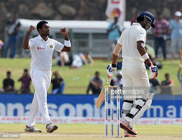 Sri Lankan cricketer Dhammika Prasad celebrates after dismissing Indian batsman Lokesh Rahul during the first day of the opening Test cricket match...