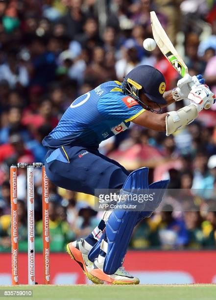 Sri Lankan cricketer Dhanushka Gunathilaka tries to avoid a bouncer of Indian cricketer Hardik Pandya during the first One Day International cricket...