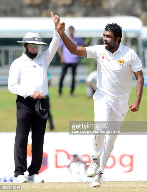 Sri Lankan cricketer Dilruwan Perera celebrates after he dismissed Bangladesh Mominul Haque during the final day of the opening Test match between...