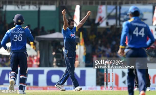 Sri Lankan cricketer Dilruwan Perera celebrates with teammates after he dismissed Bangladesh batsman Soumya Sarkar during the third and final one day...