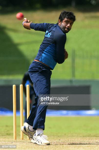Sri Lankan cricketer Dilruwan Perera delivers a ball during a practice session at the Sinhalease Sports Club Ground in Colombo on August 2 2017 The...