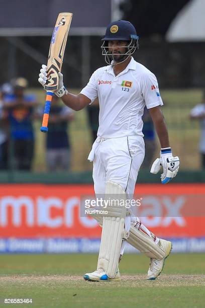 Sri Lankan cricketer Dimuth Karunaratne celebrates after scoring 50 runs during the 3rd Day's play in the 2nd Test match between Sri Lanka and India...