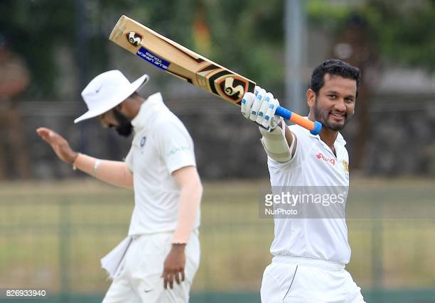 Sri Lankan cricketer Dimuth Karunaratne celebrates after scoring a century during the 4th Day's play in the 2nd Test match between Sri Lanka and...