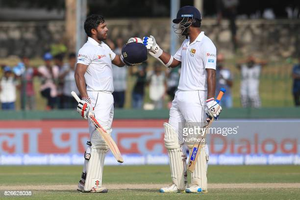 Sri Lankan cricketer Dimuth Karunaratne joins in to celebrate after Kusal Mendis scored a century during the 3rd Day's play in the 2nd Test match...