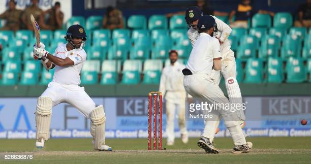 Sri Lankan cricketer Dimuth Karunaratne plays a shot during the 3rd Day's play in the 2nd Test match between Sri Lanka and India at the SSC...