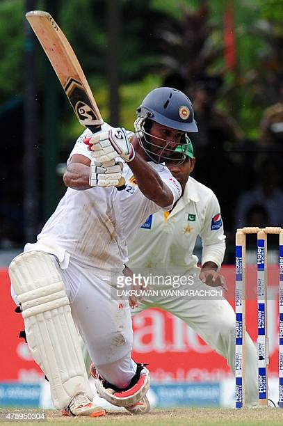 Sri Lankan cricketer Dimuth Karunaratne plays a shot during the final day of the second Test cricket match between Sri Lanka and Pakistan at the P...