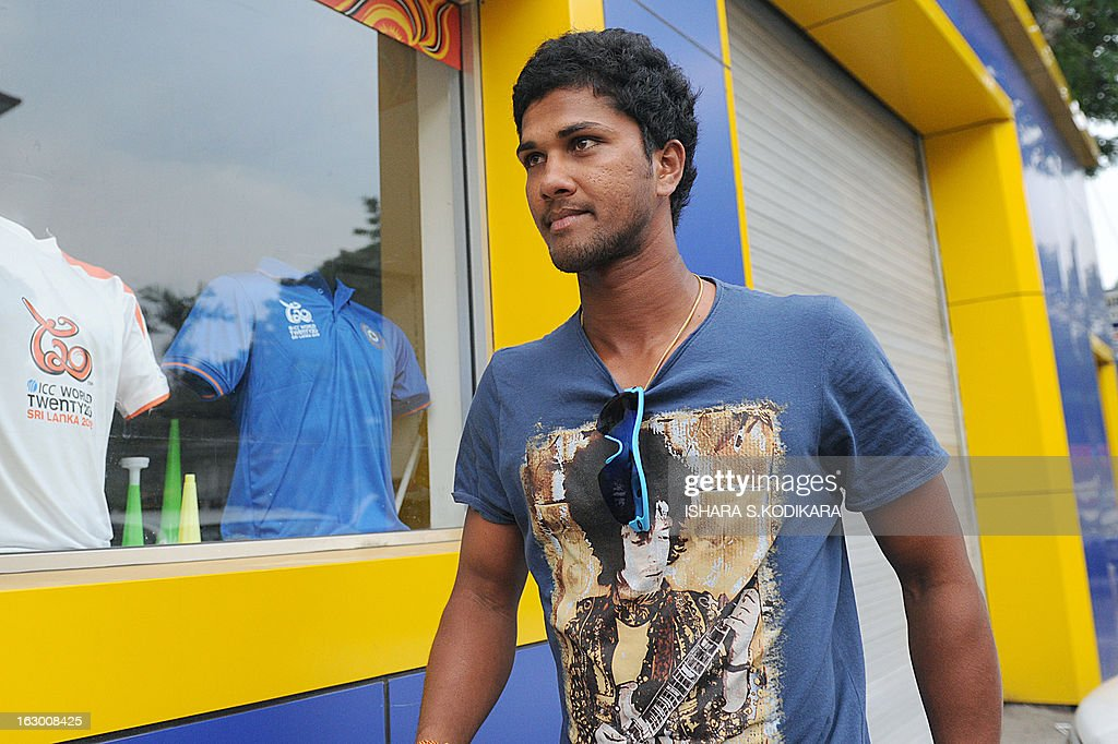Sri Lankan cricketer Dinesh Chandimal arrives at the Sri Lanka Cricket office to hold talks with selectors in Colombo on March 3, 2013. Sri Lanka's national cricketers dropped a controversial pay demand today, clearing the way for them to play against Bangladesh in an upcoming series, a top official said. Chief Selector Sanath Jayasuriya said he held crisis talks with the rebellious players who agreed to the same terms and conditions offered by Sri Lanka Cricket (SLC) and would be available for selection for the first Test starting March 8. AFP PHOTO / Ishara S